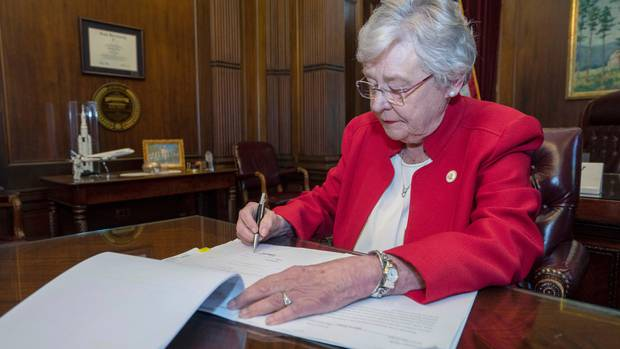 Alabama Governor Kay Ivey signing a bill that virtually outlaws abortion in the state. (Photo / AP)