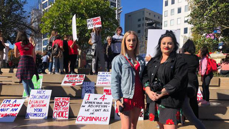 Pro-choice protesters face off with pro-life rally in Auckland