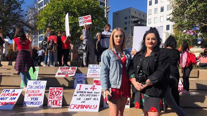 Protest organisers Kayla Bunce, left, and Tegan Tinsley, right, at the rally in Aotea Suqare. Photo / Alice Peacock