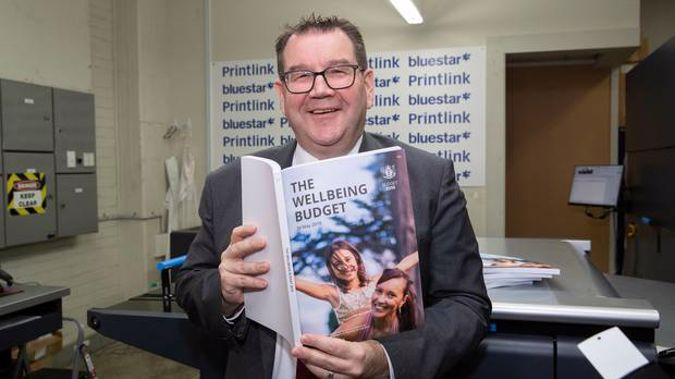 Finance Minister Grant Robertson during his visit to PrintLink in Petone to view copies of his 2019 The Wellbeing Budget hot off the press. Photo / Mark Mitchell