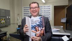 Finance Minister Grant Robertson during his visit to PrintLink in Petone to view copies of his 2019 The Wellbeing Budget hot off the press. Photo / Mark Mitchell.