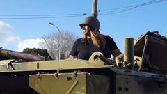 Makere Edmonds-Phillips in the ex-British Army FV432 APC vehicle on her dad's front lawn. Photo / Supplied