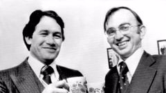 A happy smile from the new MP for Hunua, Mr Winston Peters, (left), as he clinks teacups with junior government whip, Mr D.M.J. (Dail) Jones in 1979. Photo / Herald Archive