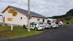 Police have set up their operation in the Hauturu School hall on Harbour Rd after an incident left one person dead and three others injured. Photo / Dean Taylor