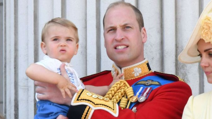 Prince Louis watches the festivities in the arms of his father William. (Photo / Getty)