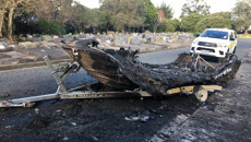 Boat owner tells how boat was stolen, ended up ablaze in Auckland cemetery