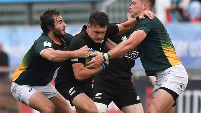 Billy Proctor of New Zealand U20 is tackled by during the game against South Africa U20. Photo /Getty