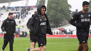 The Black Caps run from the field during rain. Photo / Photosport