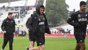The Black Caps run from the field during rain. Photo / Photosport