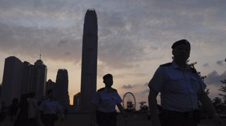 Hong Kong set for street march, mourns death of protester