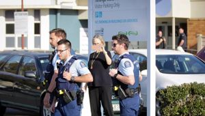 Police attend the scene of an Oranga Tamariki uplifting. (Photo / NZ Herald)