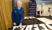 Police Senior Sergeant Paddy Hannon with weapons that are now illegal. Some members of the Council of Licenced Firearms Owners are reluctant to hand in their firearms. Photo / Mark Mitchell