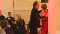 UK politician suspended after grabbing climate protester by neck