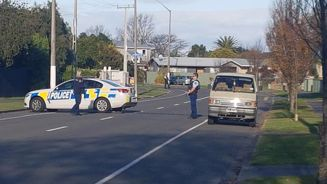 Man in Napier standoff holding baby when he surrendered to police