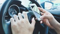 Queensland drivers to be hit with $1000 fines for using their phones