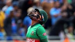 Bangladesh's Mushfiqur Rahim reacts as he leaves the field after being dismissed by India's Yuzvendra Chahal. (Photo / AP)