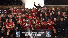 The Crusaders celebrate with the Super Rugby trophy. (Photo / Getty)