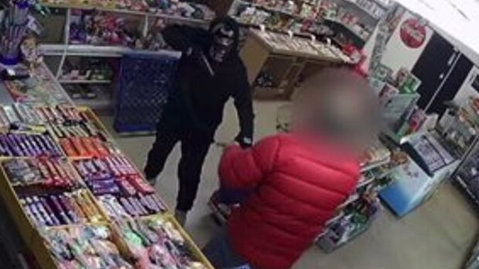 Police are hunting the masked robber. (Photo / Police)
