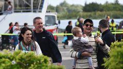 Jacinda Ardern, Clarke Gayford and baby Neve at the airport in Rarotonga. Photo / Cook Islands News