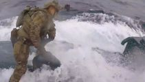 Watch: US Coast Guard boards moving submarine in high seas drugs bust