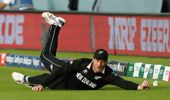 Martin Guptill attempts to catch England's Ben Stokes ball in the super over at the end of the Cricket World Cup final match between England and New Zealand. (Photo / AP)