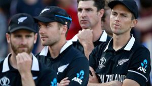 New Zealand's Trent Boult, right, crosses his arms as he waits for the trophy presentation after losing the Cricket World Cup final match between England and New Zealand. Photo / AP
