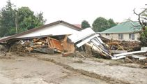Residents of storm-struck town urged to accept offer to buy houses