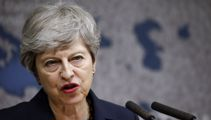 UK leader Theresa May slams populist politics and Brexit 'absolutism'