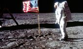 "Astronaut Edwin ""Buzz"" Aldrin poses next to the U.S. flag on the moon during the Apollo 11 mission, on July 20, 1969.  Photo / Getty Images"