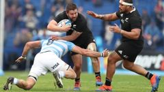 New Zealand's All Blacks Dane Coles, center, is tackled by Argentina's Los Pumas Javier Ortega Desio during a rugby championship match in Buenos Aires. (Photo / AP)