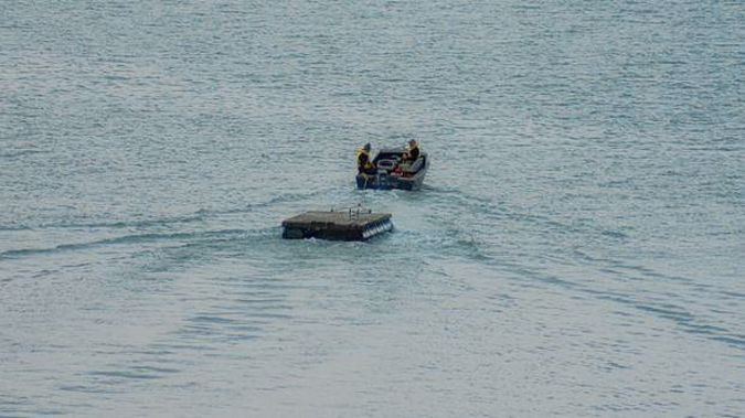 Police have posted this image of a pontoon being stolen on Waiheke Island in June. (Photo / NZ Police Facebook)