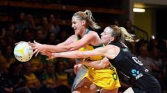 Caitlin Bassett of the Diamonds contests the ball with New Zealand's Katrina Rore. Photo / Getty
