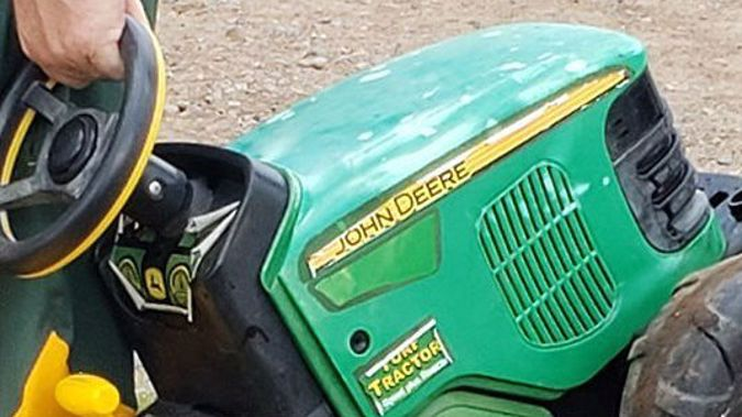The toy tractor that the two-year-old escaped on. (Photo / CNN)