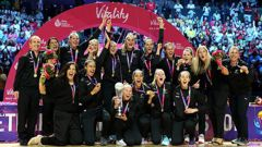 New Zealand's Laura Langman lifts the trophy with her team mates after winning the Netball World Cup. Photo / Getty