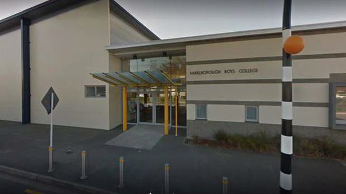 A woman has been charged as part of an ongoing investigation into sexual allegations at Marlborough Boys' College.