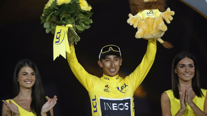 Colombia's Egan Bernal stands on the podium after winning the 2019 Tour de France. (Photo / AP)