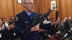 Police acting superintendent Mike McIlraith demonstrates to a select committee in Parliament the types of weapons and magazines that will be banned under the new firearms legislation. Photo / Jason Walls