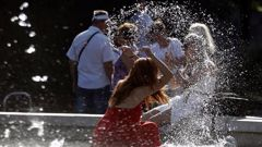 A woman cools off in a public fountain in front of the Sforza Castle in Milan, Italy as Europe's heatwave continued in July. Photo / AP