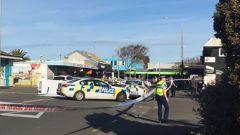 Police block a road in New Brighton, Christchurch, after a pedestrian was killed following being struck by a car that was involved in a police chase. (Photo / Lavinia Bishop)