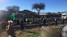 Protestors lock themselves to train tracks in Christchurch
