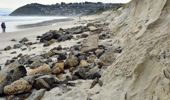 Exposed pieces of rock, concrete, brick and other rubble lie on the sand at Dunedin's Ocean Beach after high seas stripped away sand protecting an old landfill. Photo / ODT