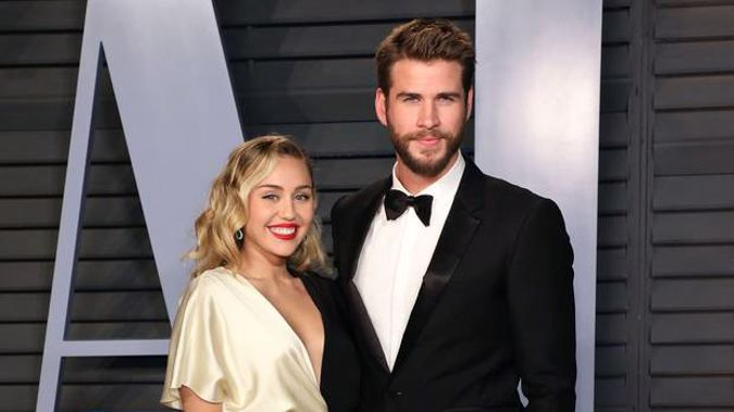 Miley Cyrus and Liam Hemsworth, seen here at the 2018 Vanity Fair Oscar Party, have announced their separation. (Photo / Getty)