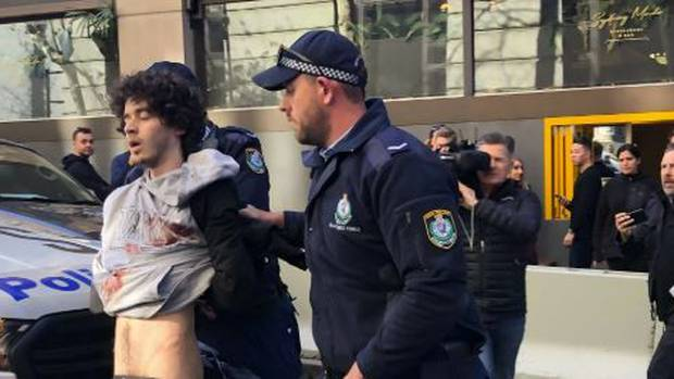 Woman found dead, man arrested after major police operation in Sydney CBD