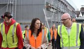 Mana in Mahi participant Tipene Van Den Anker walks around Tunnicliffes Timber with Prime Minister Jacinda Ardern and Tunnicliffes co-owner Scott McCabe. Photo / Katee Shanks