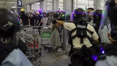Hong Kong protesters may save their democracy but lose their economy. (Photo / AP)