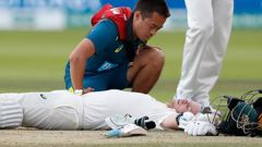 Australia's Steve Smith receives treatment as lies on the ground after being hit on the head by a ball bowled b England's Jofra Archer during play on day four of the 2nd Ashes Test. (Photo / AP)