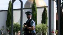 A police officer stands outside the Al Noor mosque, one of the sites of the March 15 shooting. (Photo / File)