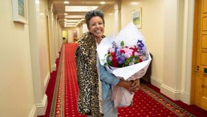 National Party deputy leader Paula Bennett with a larger bunch of flowers than those she sent to Winston Peters. (Photo / Mark Mitchell)