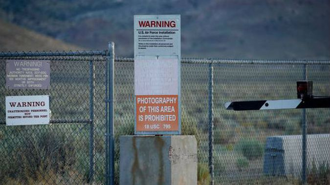 Signs warn about trespassing at an entrance to the Nevada Test and Training Range near Area 51 outside of Rachel, Nevada. (Photo / AP)