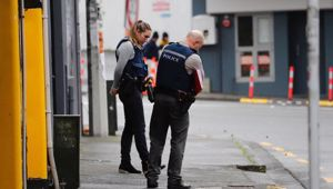 Police at the scene on Cross St after a person suffered serious injuries in a suspected shooting last night. (Photo / Dean Purcell)